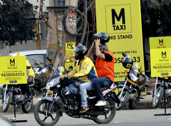 Riding pillion, the bike taxi way