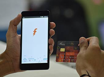 Digital payments firm FreeCharge ties up with grocery retailer Heritage Fresh