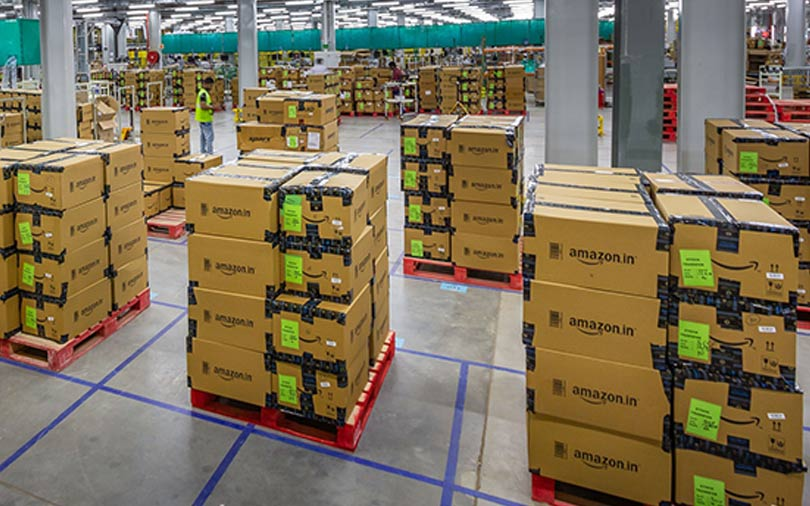 Even in 50th India warehouse, Amazon pushes forward with humans, not robots
