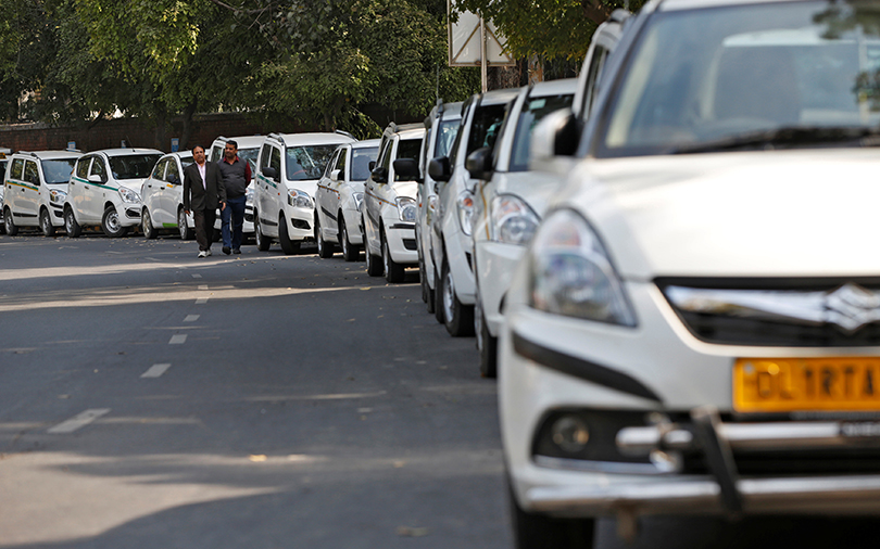 India's competition watchdog dismisses price-fixing charges against Uber, Ola