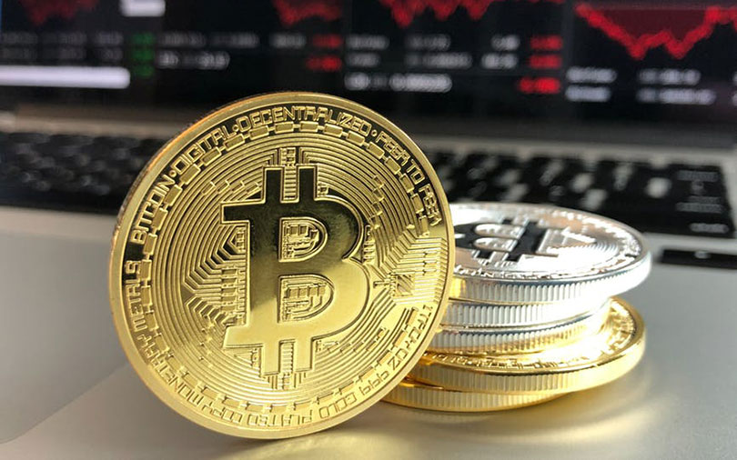 Bitcoin slides over 7%, heads towards one-year low