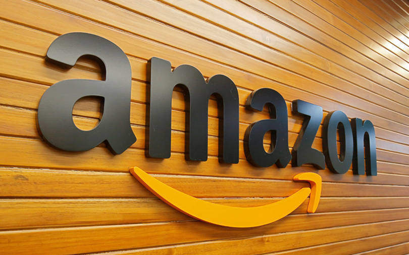 Amazon reports lower profit, invests in one day shipping, cloud infrastructure